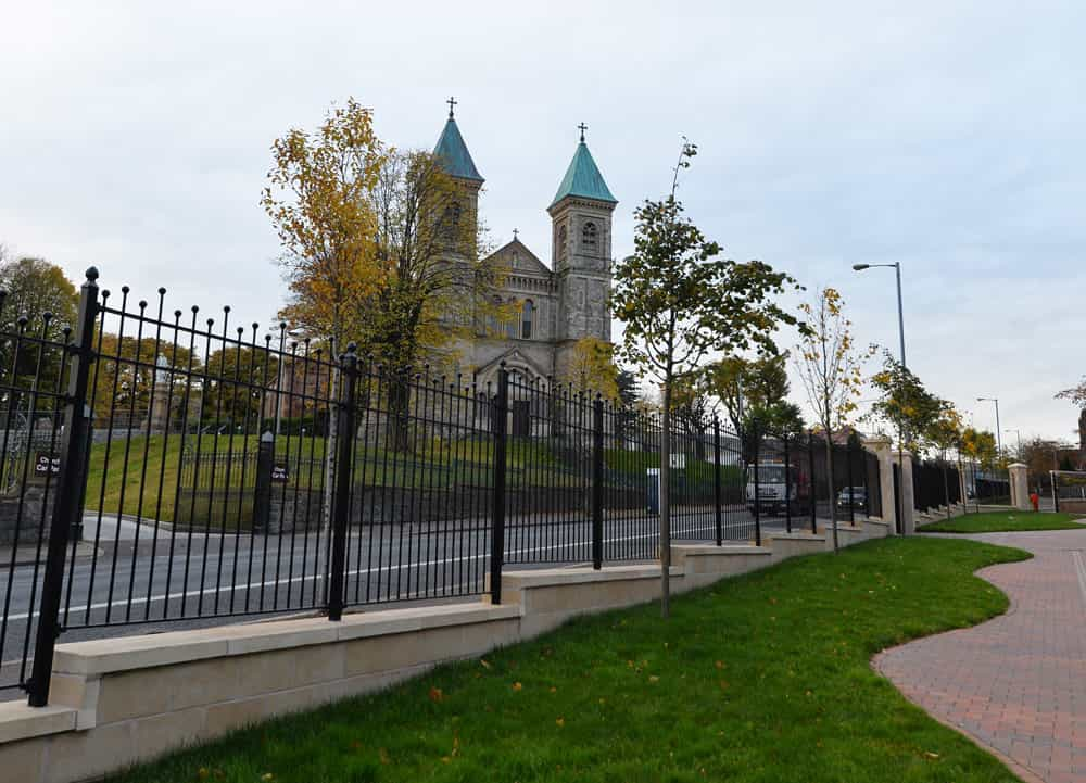 After image of the Crumlin Road Peace Wall that has now been made into a landscaped area with decorative railings.